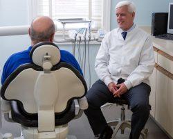 Dentist Donald Plourde treating patient